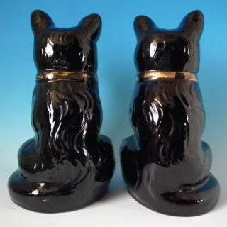 Pair Staffordshire Jackfield cats with glass eyes