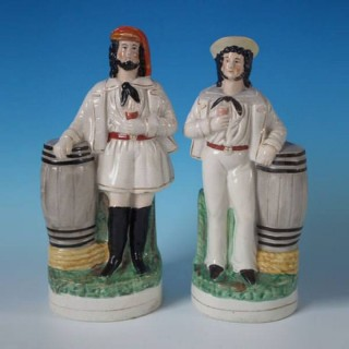 Pair Staffordshire sailor & barrel figures