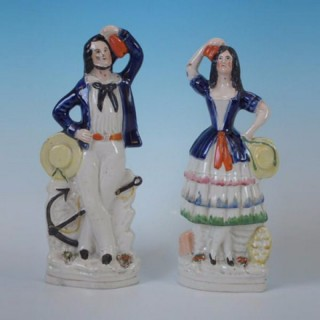 Pair Staffordshire sailor & lass figures