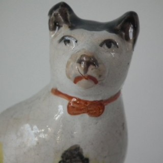 Small Staffordshire cat on a cushion figure