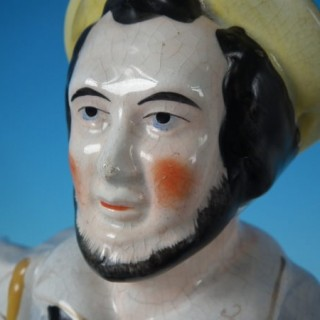 Staffordshire sailor in boat with flag figure
