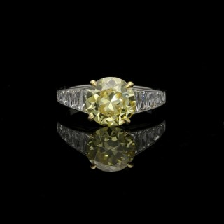 Hancocks Stunning 2.41 carat Fancy Intense Yellow Diamond Ring with tapering French-cut Diamond shoulders