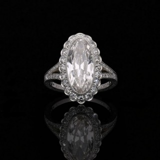 Hancocks 3.35 carat Moval Diamond Ring with Scalloped Halo surround and elegant split shoulders