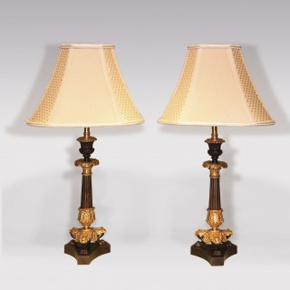 A pair of mid 19th Century bronze and ormolu Candlesticks.