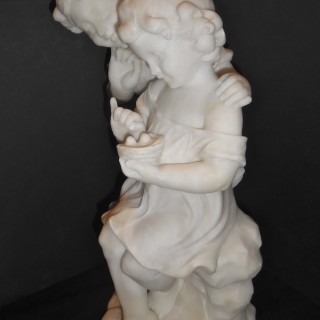 A French alabaster sculpture of children