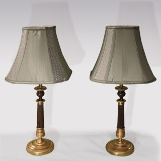 Pair of early 19th Century bronze and ormolu Candlestick Lamps.