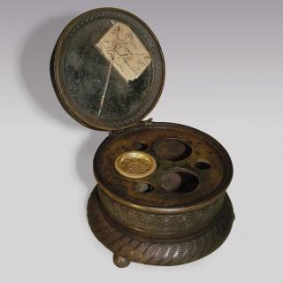 A Regency period circular bronze Inkwell.