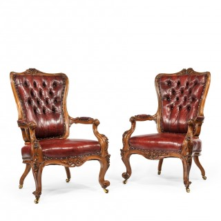 pair of large Victorian walnut arm chairs