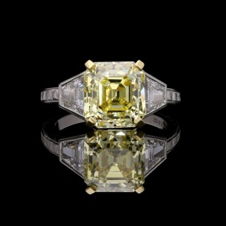 4.97 carats  Fancy Intense Yellow Diamond Ring with Trapezoid shoulders and hand engraving