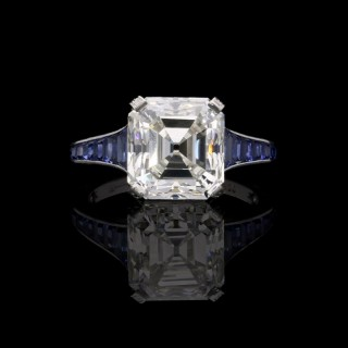 Hancocks 5.03 carat  Asscher cut Diamond Ring with elegant tapering Calibre cut Sapphire shoulders