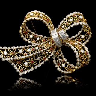 Vintage ruby and diamond bow brooch, circa 1960.