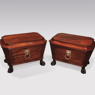 A rare pair of Regency period well-figured sarcophagus-shaped Wine Coolers.