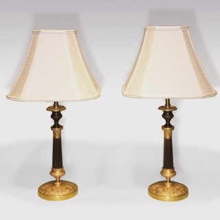 A pair of early 19th Century bronze and ormolu Candlesticks.