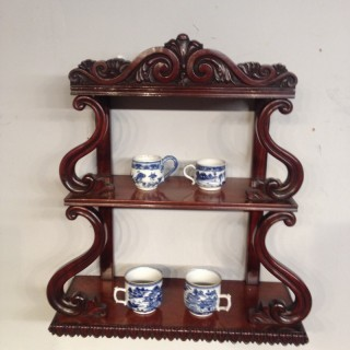 Regency mahogany hanging shelves.