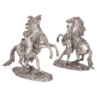 Pair of silvered bronze models of the Marly horses after Guillaume Coustou