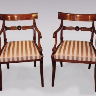 A matched pair of early 19th Century mahogany Arm Chairs.