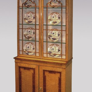 A 19th Century Birdseye Maple Display Bookcase.