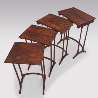A set of Regency period padouk wood Quartetto Tables.