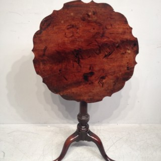 George II carved  mahogany tripod table.