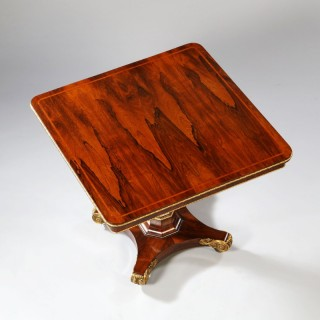A FINE REGENCY ROSEWOOD TILT TOP CENTER TABLE