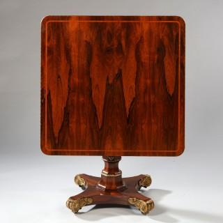A FINE REGENCY ROSEWOOD TILT TOP CENTER TABLE