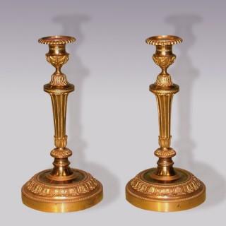 A Pair of mid-19th Century Louis XVI style ormolu Candlesticks.