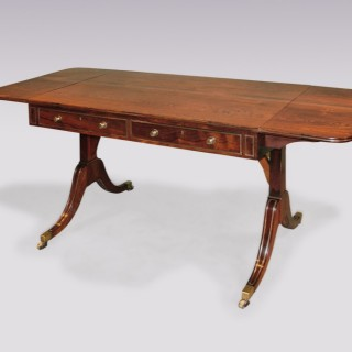 A Regency period rosewood and brass moulded Sofa Table.