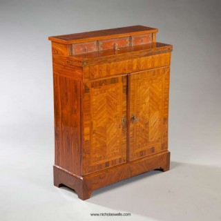 A NARROW KINGWOOD SIDE CABINET WITH FOLD OVER WRITING SURFACE