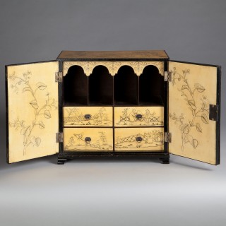 A REGENCY YELLOW JAPANNED LACQUER CABINET