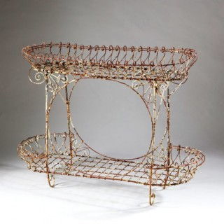 A VINTAGE WIRE WORK TWO TIER JARDINIERE