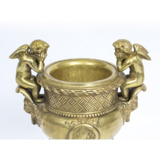 Antique Pair of French Gilt Bronze Urns Flanked by Cherubs 19th C
