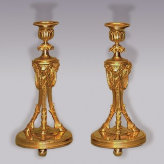 A well cast pair of mid 19th Century ormolu Candlesticks.
