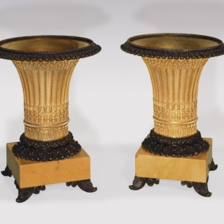 A fine pair of early 19th Century bronze and ormolu gothic style vase-shaped Tazzas.