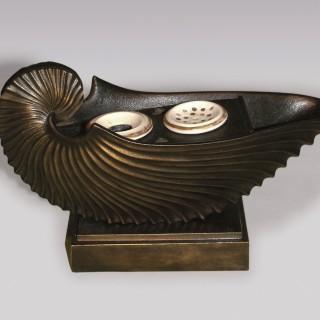 A 19th Century cast iron Nautilus Inkwell.
