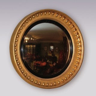 An early 19th Century Regency period giltwood Convex Mirror.