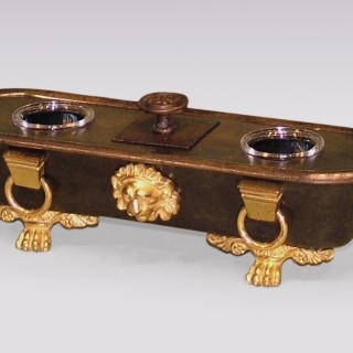 An early 19th Century Regency period bronze & ormolu Roman Bath shaped Inkwell.