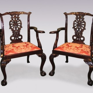 A pair of Chippendale style mahogany Armchairs.