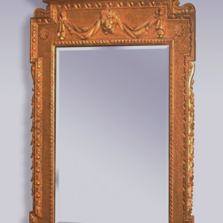 A George II period giltwood Looking Glass.