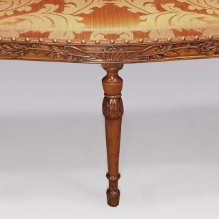 An unusual Adam period carved mahogany Window Seat.