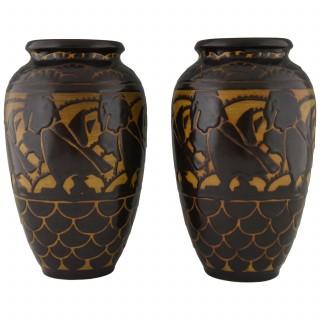 A pair of Art Deco ceramic vases with birds.