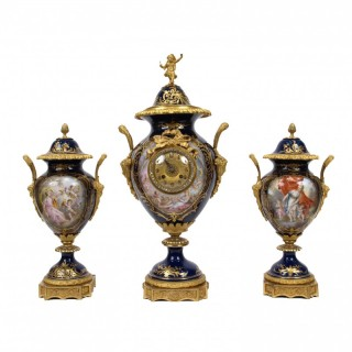 Antique clock garniture with Sevres style porcelain and ormolu