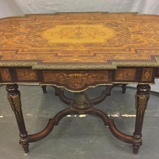 A Napoleon III period ormolu mounted marquetry table