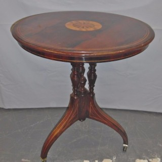An Edwardian inlaid rosewood circular side table