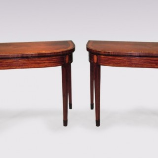 A pair of Sheraton period well-figured mahogany Card Tables.
