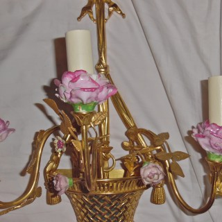 A French pair of porcelain mounted ormolu wall lights