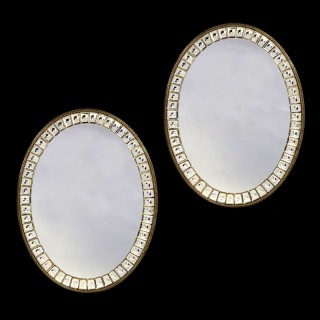 PAIR OF 19TH CENTURY OVAL MIRRORS