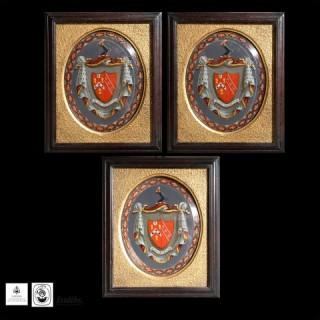 THREE ARMORIAL EGLOMISE PANELS OF THE EDDINGER FAMILY