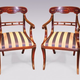 Pair of Regency period mahogany Armchairs with sabre legs.