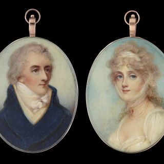 A pair of portrait miniatures of Lady Isabel Anne (née Maitland) (1772-1858) and her husband Sir Francis Dashwood; she wearing white dress and gauze headdress, a coral cross and beads at her neck; he wearing blue coat and pale yellow waistcoat (2)