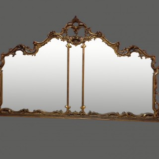 Large carved rococo giltwood overmantel mirror.
